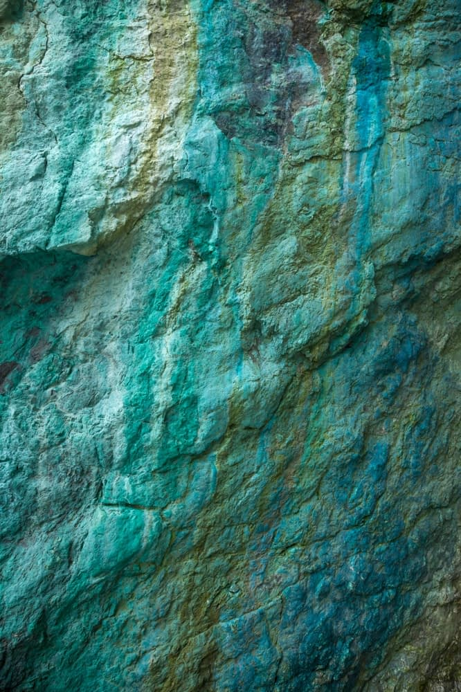 Copper mineral deposits in a cliff face, Copper Coast, County Waterford, Ireland.
