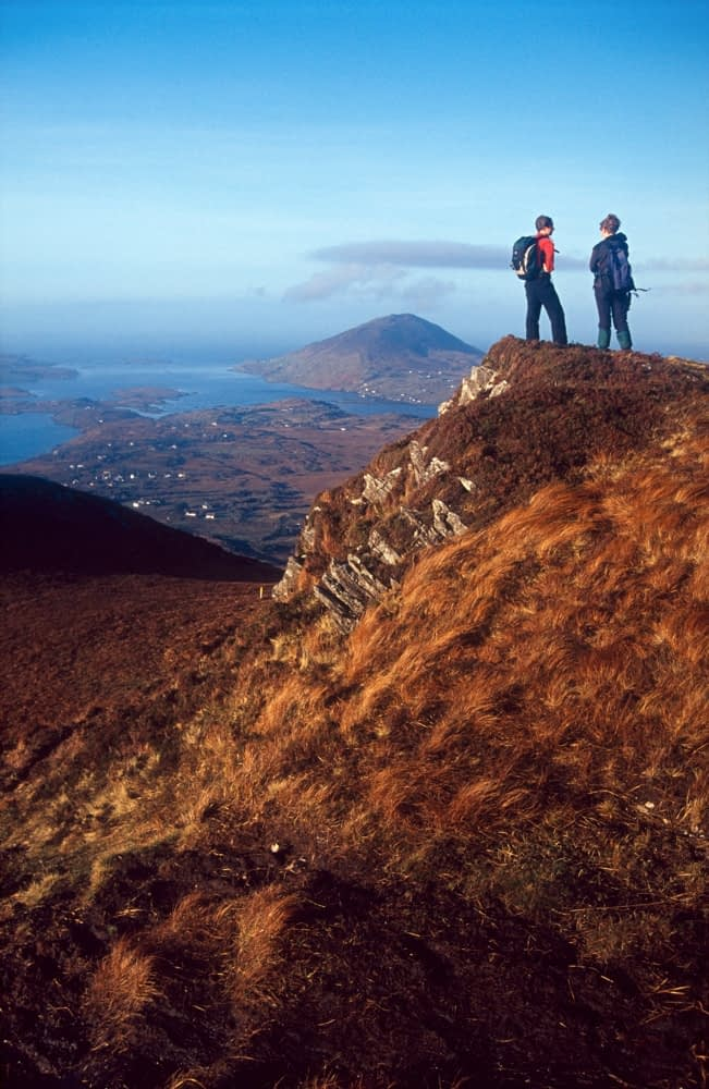 Walkers at the summit of Diamond Hill, Connemara National Park, Co Galway, Ireland.