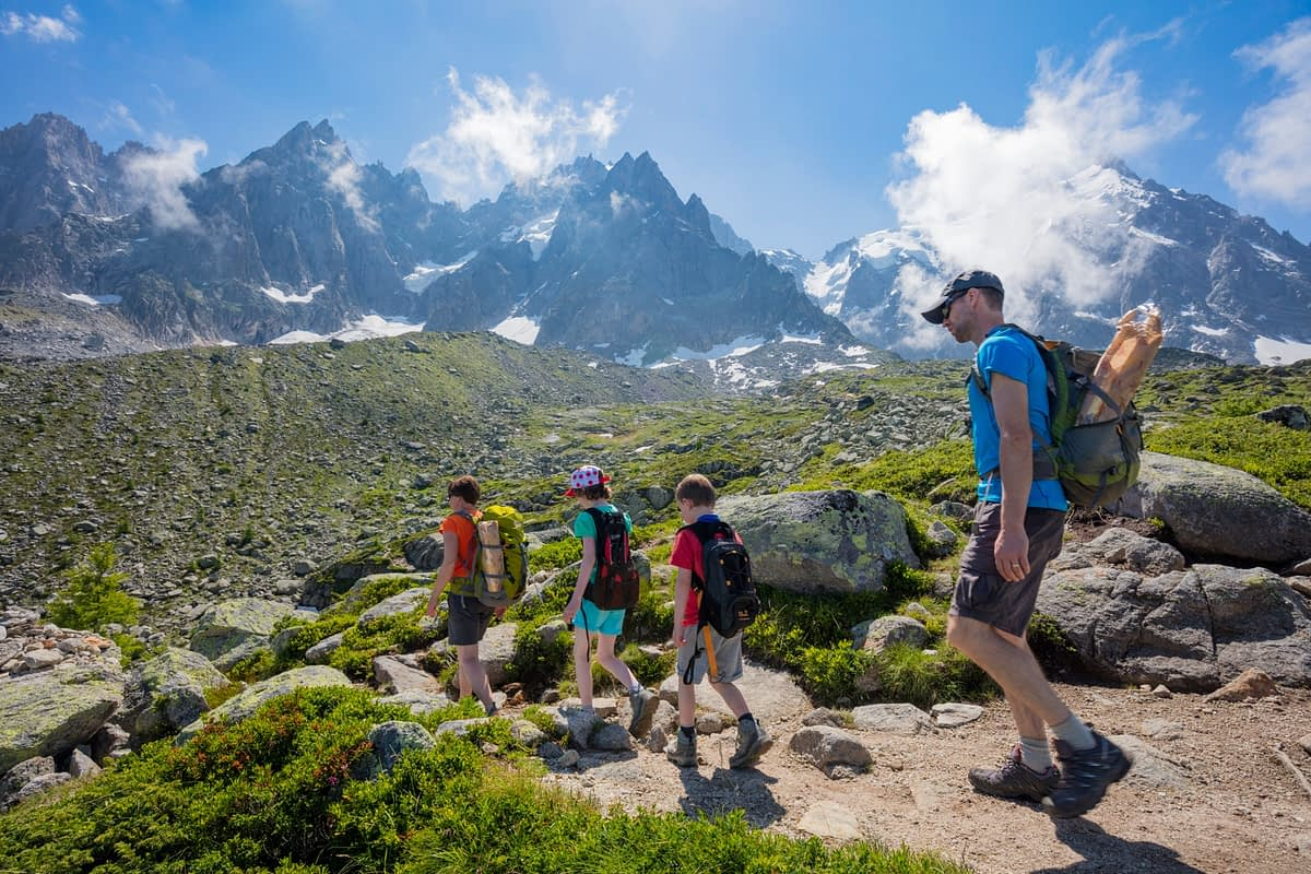 Family hiking on the Grand Balcon Nord, Chamonix Valley, French Alps, France.