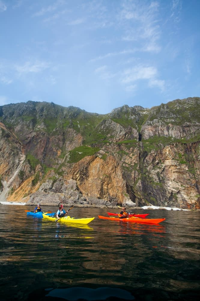 Sea kayaking beneath the Slieve League cliffs, County Donegal, Ireland.