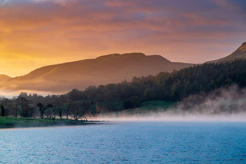 Dawn mist over Glencar Lake, County Sligo, Ireland.