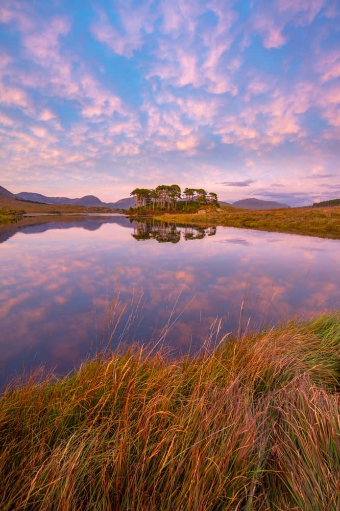Sunset reflections in Derryclare Lough, Connemara, County Galway, Ireland.