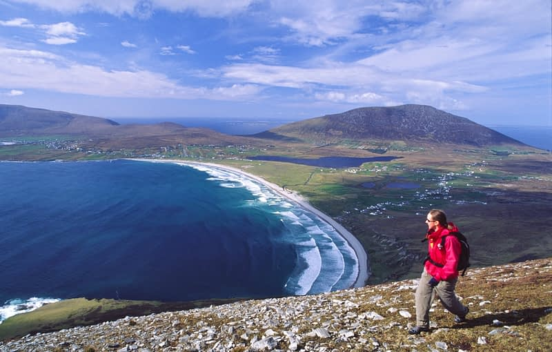 Walker on the Menawn Cliffs, Achill Island, Co Mayo, Ireland.