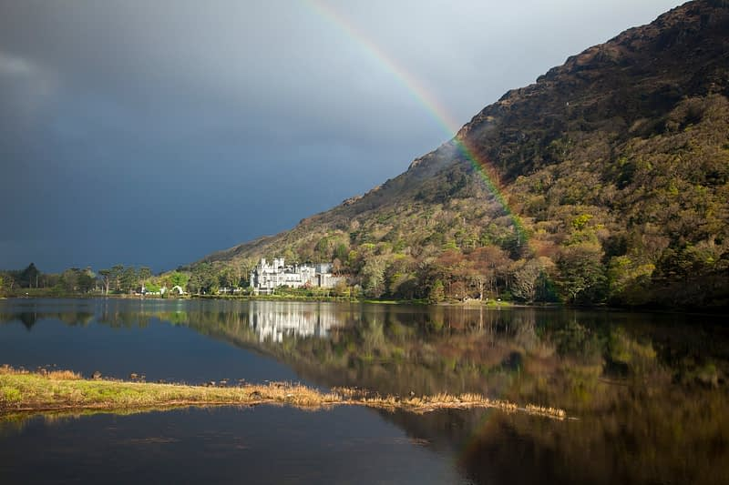 Rainbow over Kylemore Abbey, Connemara, Co Galway, Ireland.
