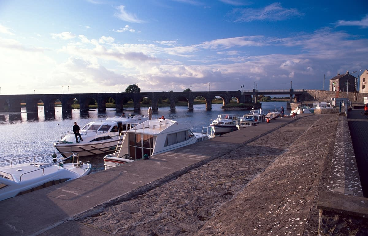 Cruising boats moored along the River Shannon, Shannonbridge, Co Offaly, Ireland.
