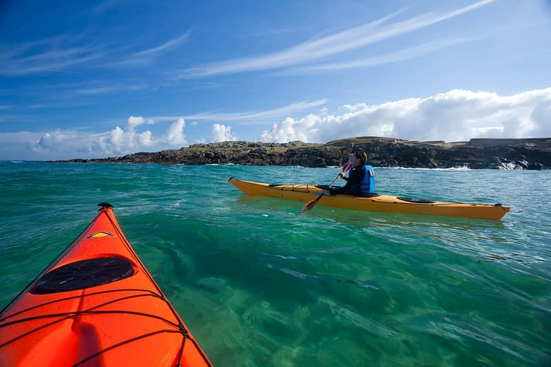 Sea kayaking in False Bay, Mannin, Connemara, Co Galway, Ireland.