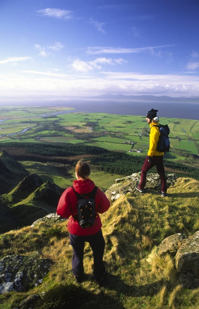 Walkers on the cliff tops of Binevenagh, Co Derry, Northern Ireland.