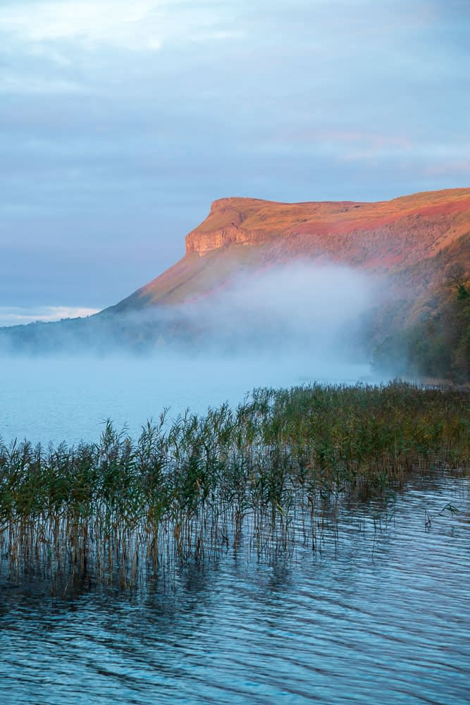 Dawn mist over Glencar Lake and Kings Mountain. County Sligo, Ireland.