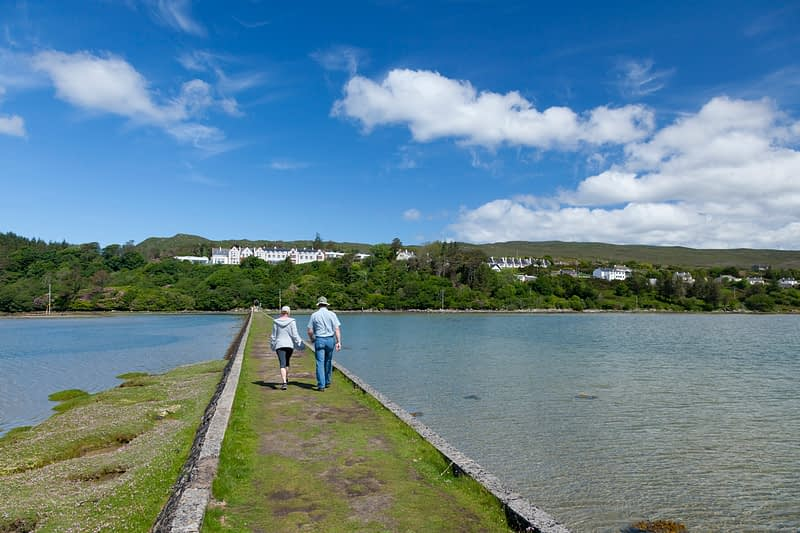 Walkers on the Victorian causeway in Mulranny, Co Mayo, Ireland.