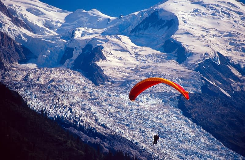 Parascending in front of Mont Blanc, French Alps, France.