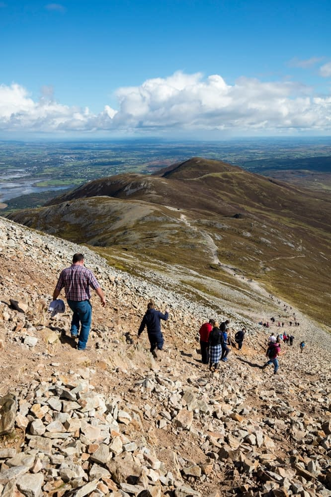 Hikers descending Croagh Patrick, County Mayo, Ireland.