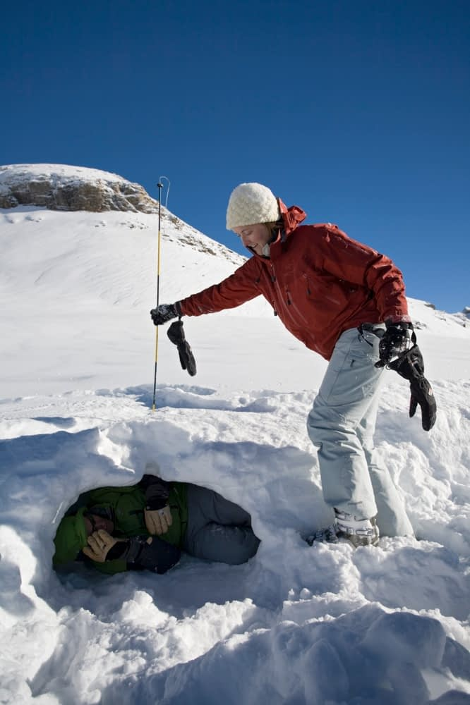Victim location during avalanche rescue training, French Alps, France.