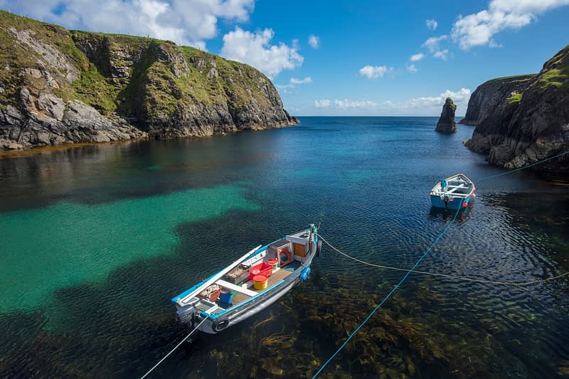 Fishing boats moored in Malin Beg Harbour, County Donegal, Ireland.