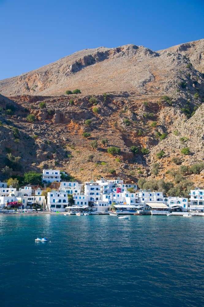 Loutro village nestles beneath the White Mountains, Crete, Greece.