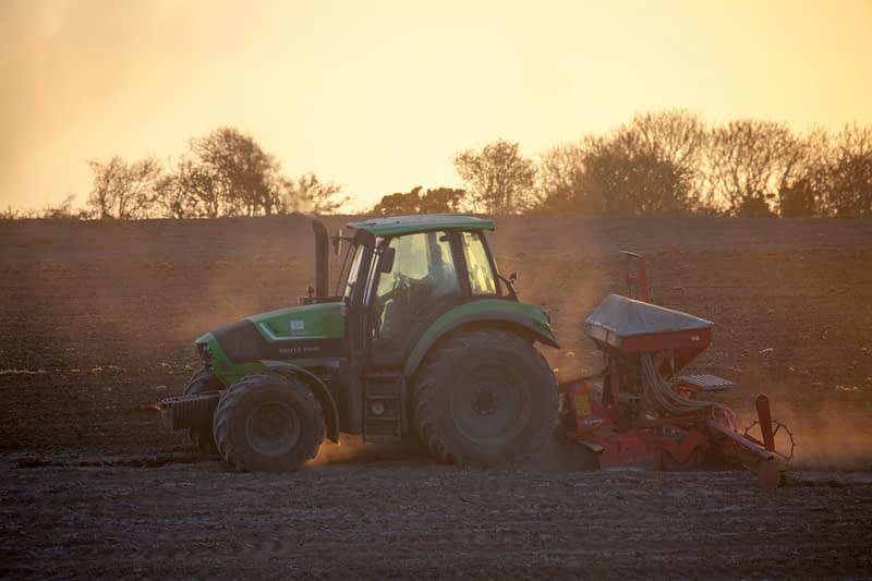 Tractor tilling a field, County Sligo, Ireland.