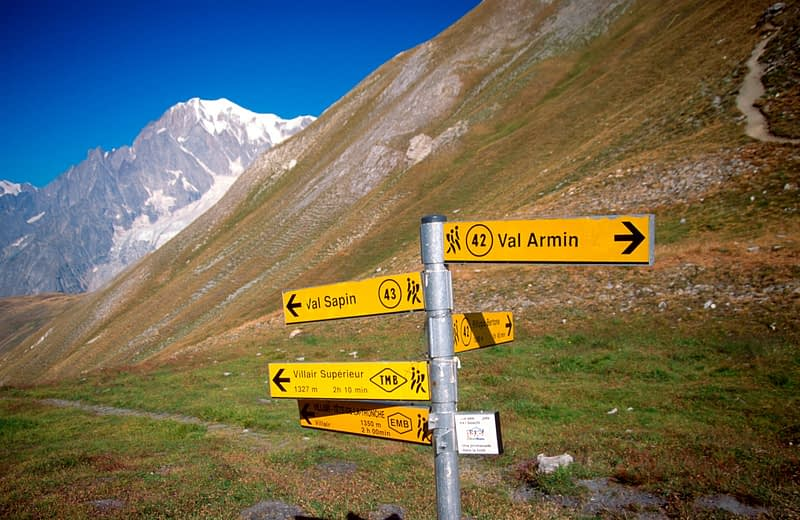 Trail signpost on the Tour of Mont Blanc, Italian Alps, Italy.
