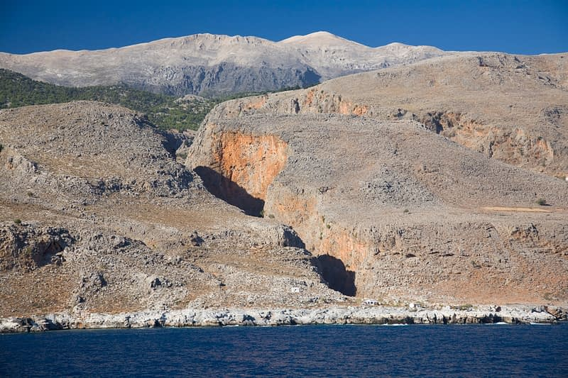 The Aradena Gorge and White Mountains seen from the sea, Crete, Greece.