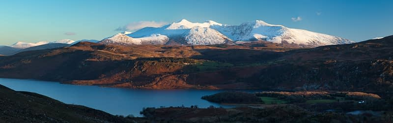 Winter MacGillycuddy's Reeks seen across Lough Caragh, County Kerry, Ireland.