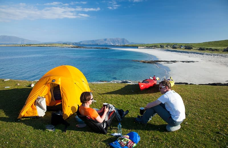 Sea kayakers camping wild on Inishkea South Island, County Mayo, Ireland.