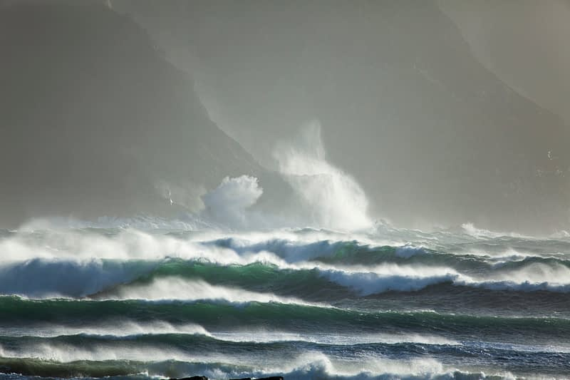 Storm waves beaking beneath the North Mayo seacliffs, County Mayo, Ireland.