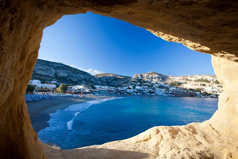 Matala beach seen from a cliff cave, Matala, Crete, Greece.