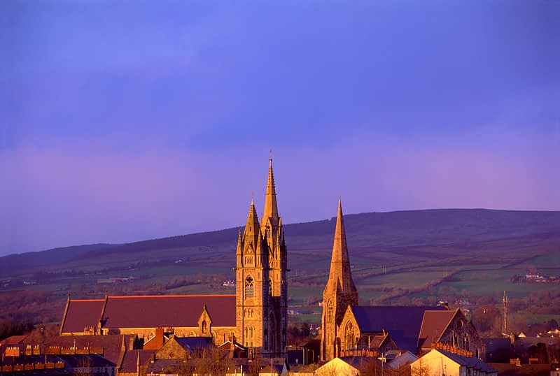 Evening light on the church spires of Omagh, Co Tyrone, Northern Ireland.