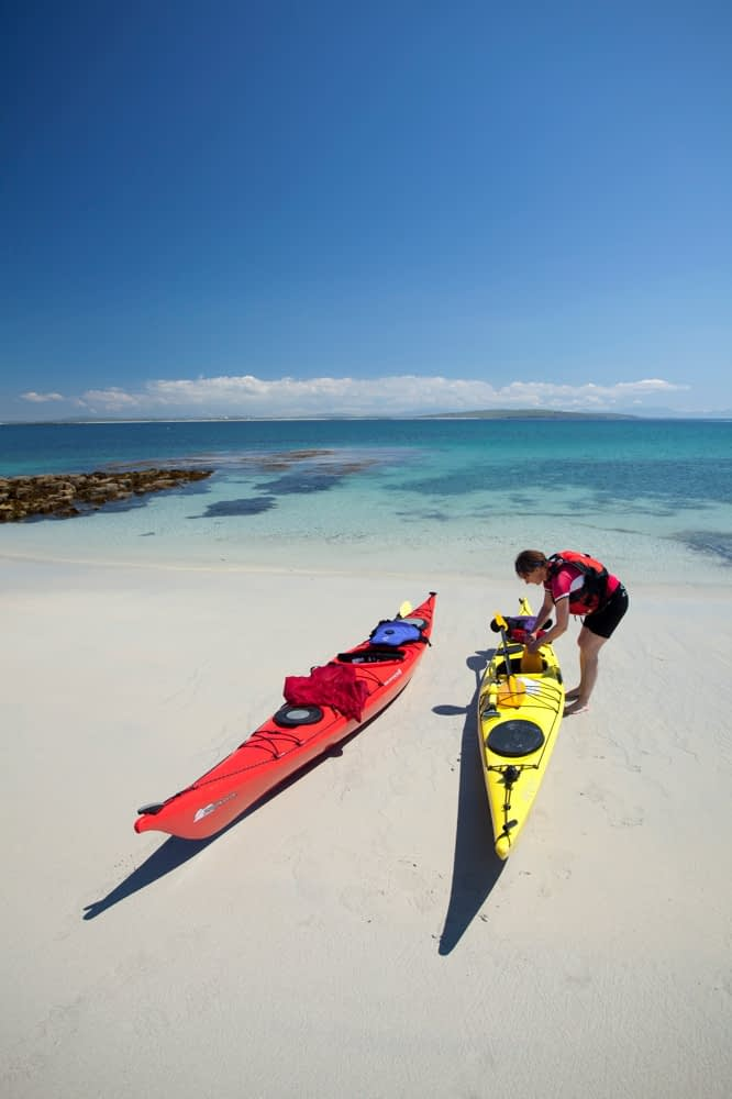 Sea kayaker on the beach, Inishkea South Island, County Mayo, Ireland.