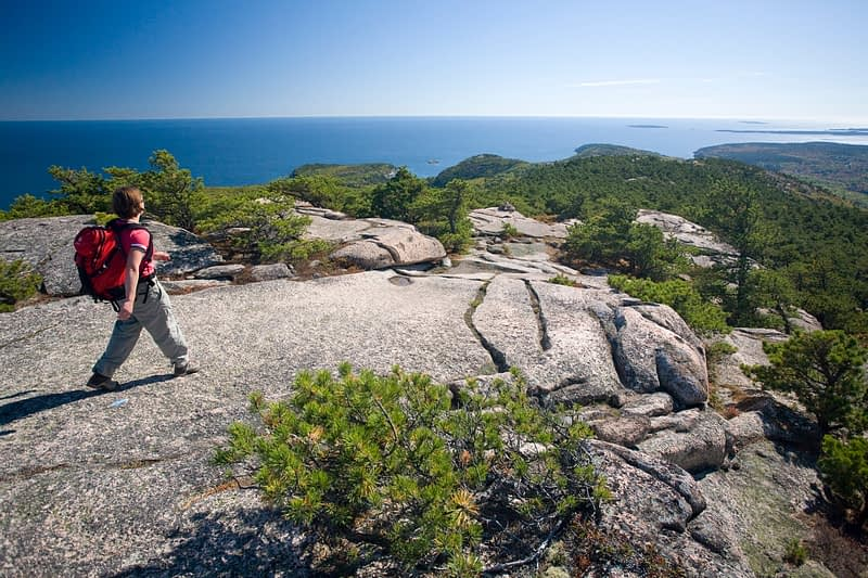 Hiker on Champlain Mountain, Acadia National Park, Maine, USA.