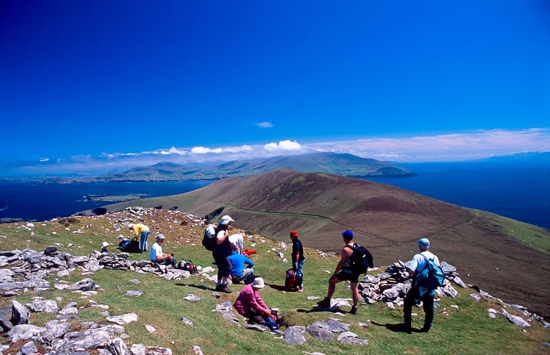 Walkers on the slopes of Slievedonagh, Great Blasket Island, Co Kerry, Ireland.