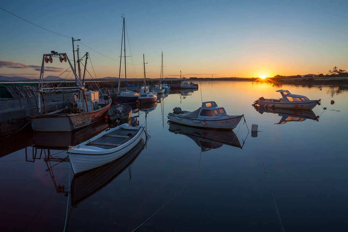 Evening fishing boats in Murrisk harbour, Clew Bay, County Mayo, Ireland.