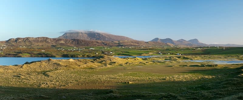 Muckish Mountain above the dunes of Tramore, Co Donegal, Ireland.
