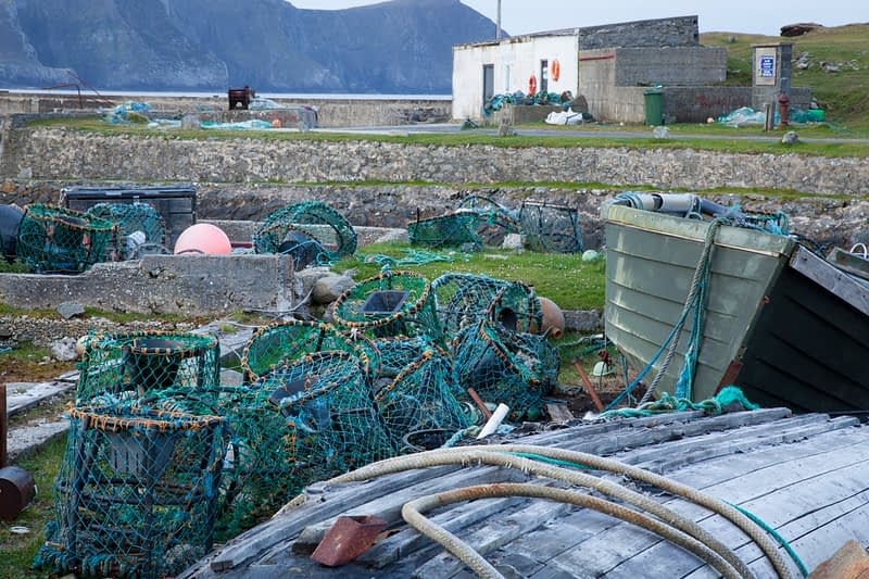 Fishing boats and lobster pots at Purteen harbour, Achill Island, Co Mayo, Ireland.