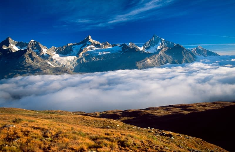 The Weisshorn rises accross a sea of cloud, Valais, Swiss Alps, Switzerland.