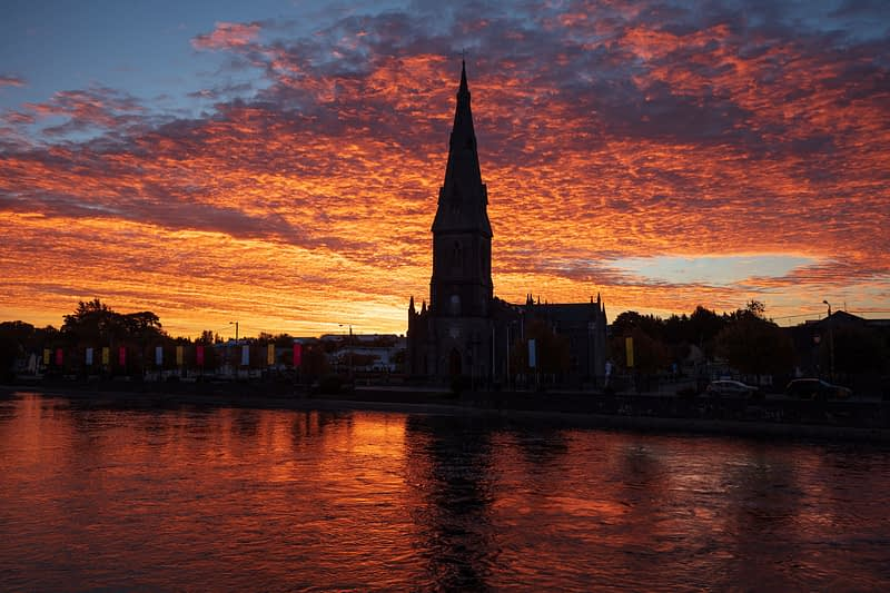 St Muredach's Cathedral and River Moy at sunset, Ballina, County Mayo, Ireland.