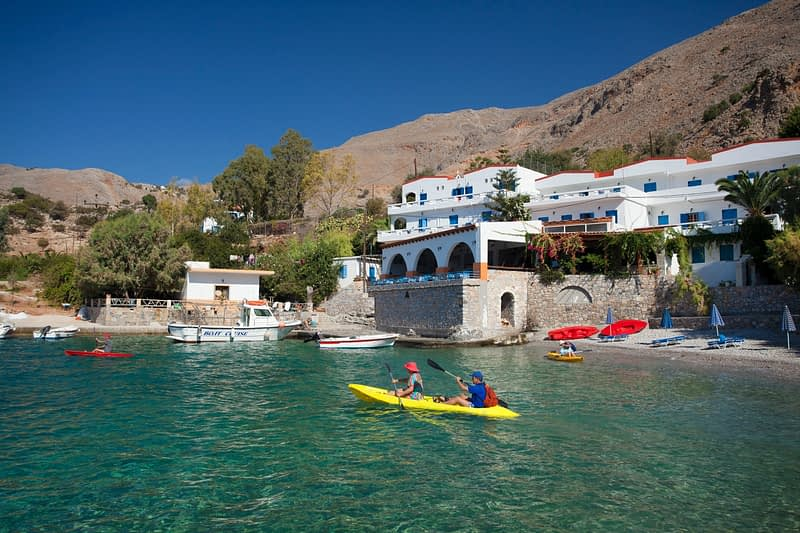 Sea kayaking near the hamlet of Finix or Phoenix, Sfakia, Crete, Greece.
