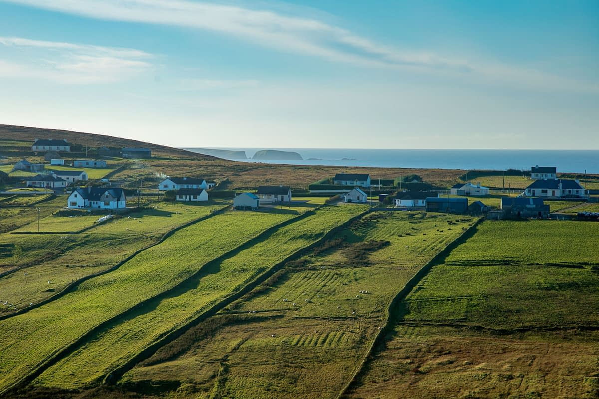 Coastal cottages and green fields at Carrowteige, County Mayo, Ireland.
