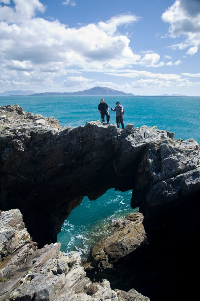 Standing on top of a sea arch, Dooega Head, Achill Island, Co Mayo, Ireland.