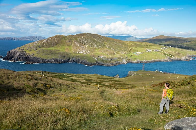Hiker looking across Dursey Sound, Dursey Island, Beara Peninsula, County Cork, Ireland.