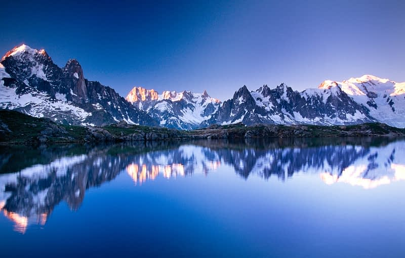 The Mont Blanc massif reflected in Lac des Cheserys, French Alps, France.