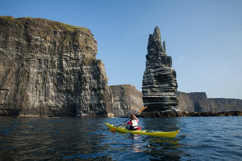 Sea kayaking beneath the Cliffs of Moher, County Clare, Ireland.