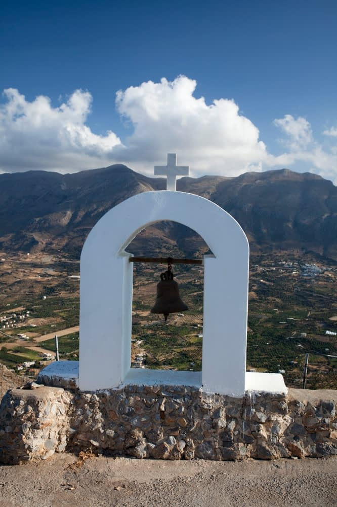 Bell of the mountain-top Timios Stavros Church, near Plakias, Crete, Greece.