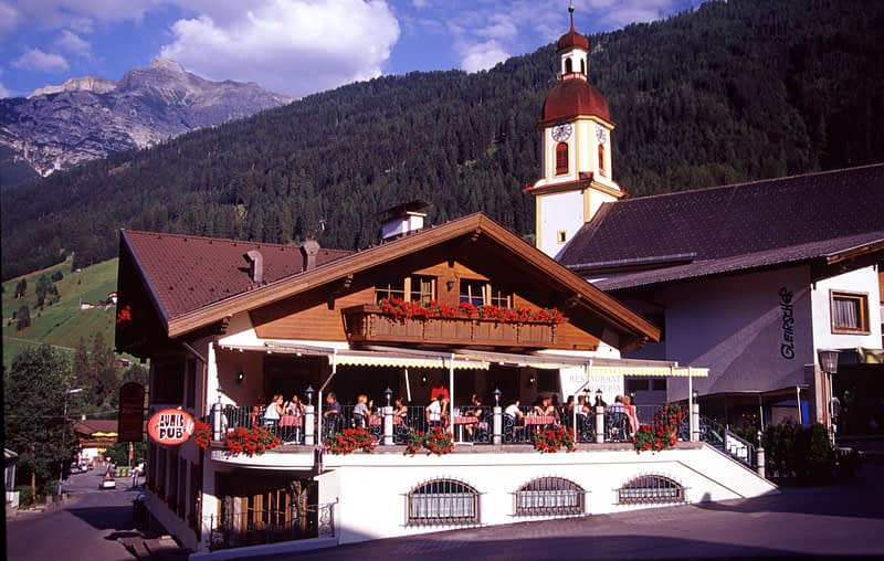 Restaurant and church, Neustift im Stubaital, Tirol, Austria.