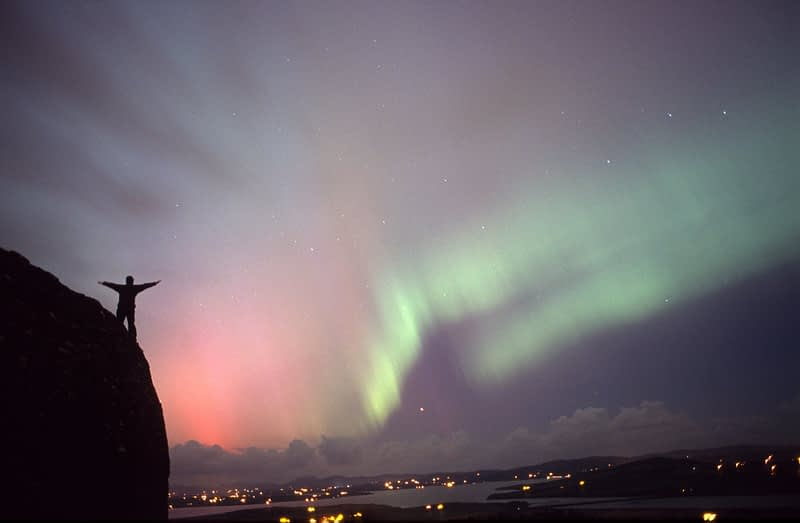Northern lights and figure silhouetted, Grianan an Aileach, Co Donegal, Ireland.