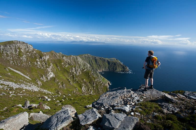 Walker looking towards Bunglas from the summit of Slieve League, County Donegal, Ireland.