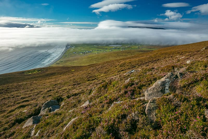 Sea fog rolling in over Keel Bay, Achill Island, County Mayo, Ireland.