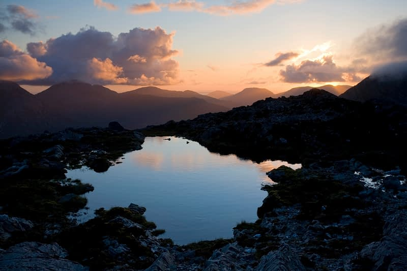 Sunset pool on the summit of Knocknahillion, Maumturk Mountains, Co Mayo, Ireland.