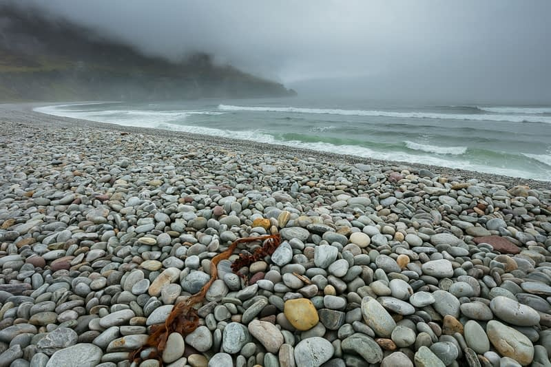 Sea fog shrouds Dookinelly beach, Achill Island, County Mayo, Ireland.