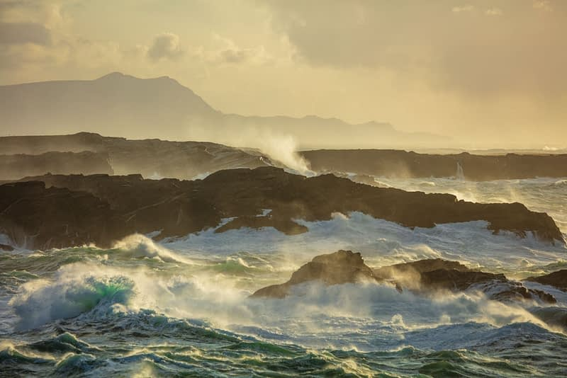 Storm waves breaking on rocky coastline, Belmullet Peninsula, County Mayo, Ireland.