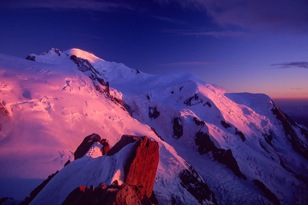 Sunset over Mont Blanc from the Aiguille du Midi, Chamonix Valley, French Alps, France.