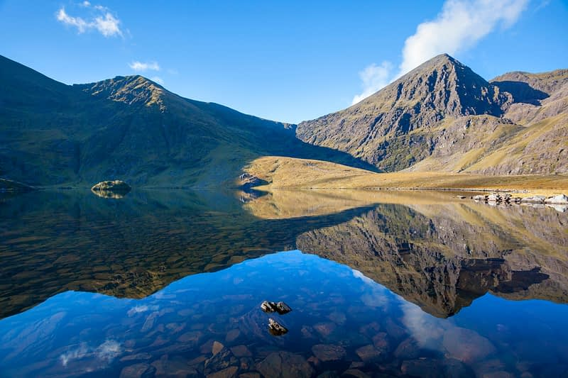 Carrauntoohil reflected in Lough Callee, Hag's Glen, MacGillycuddy's Reeks, County Kerry, Ireland.